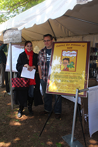 Mike Wines and a fan in front of the poster for Mike's hilarious Stupid Alabama, a tween adventure and comedy coming out in 2013.