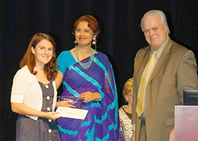 Mary Butgereit receives her check and trophy from HLA President, Dr. Monita Soni, and AWP Publisher Steve Gierhart at the YWC Awards Ceremony