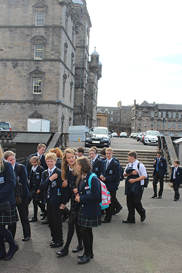 Students at Heriort's School in Edinburgh depart for the day.  Heriot's is the real school that was the basis for Hogwarts of Harry Potter fame.  J.K. Rowling taught there for a year.