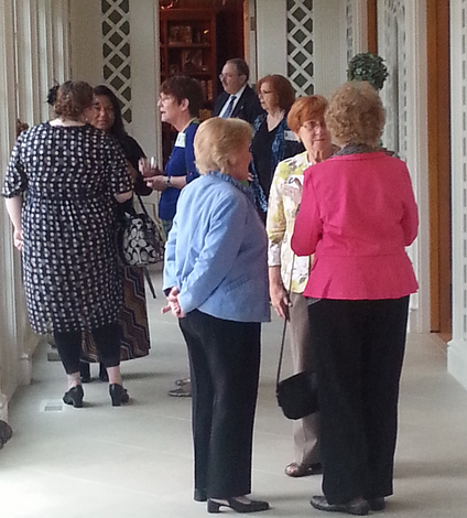 HLA members mingle at the balcony over the gardens of Les Forgerons.
