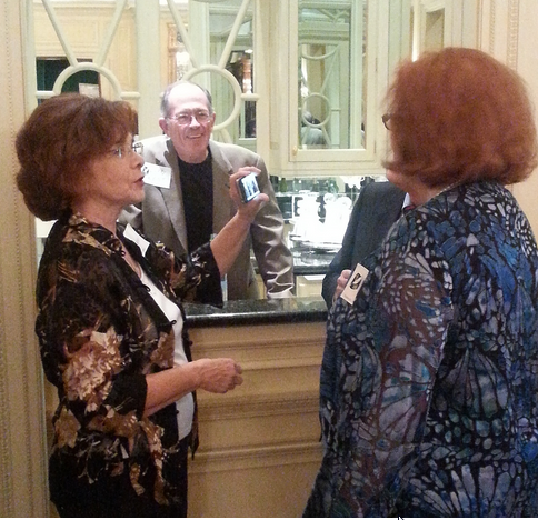 HLA member Larry West greets members at the bar at Les Forgerons.