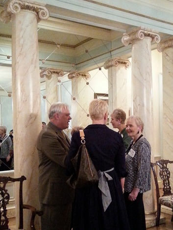 Publisher Steve Gierhart and his daughter Stephanie talk to Gayle Millberger, chair of HLA's Young Writers Contest in an anteroom of Les Forgerons.