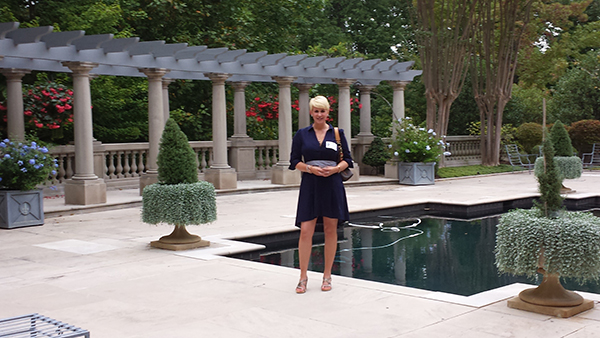 Stephanie Gierhart, daughter of Ardent Writer Press publisher Steve Gierhart, stands by the pool at Les Forgerons during HLA's annual Wine and Cheese Party on October 6th.