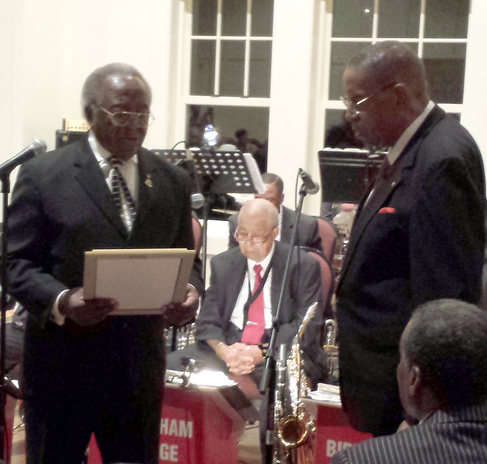 Richard Showers, Huntsville City Council member, honors Tolton Rosser, band leader for Birmingham Heritage Band