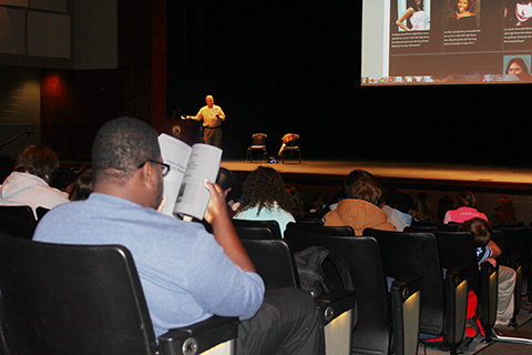 James Clemens student examines Expressions during HLA presentation on Young Writers