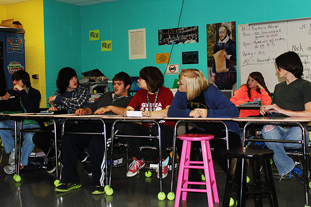 New Hope students discuss the YWC briefing, including Billy Martin, second from left, who was the model for last year's winning art prize, Restless Times,  from New Hope's Throy Bond.