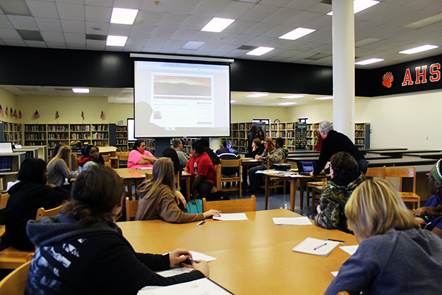 HLA briefs Austin High students in their lovely library.