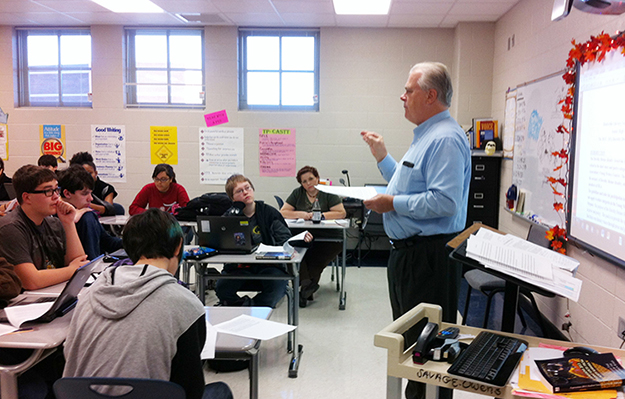 HLA briefs New Century Technology students on the Young Writers Contest.