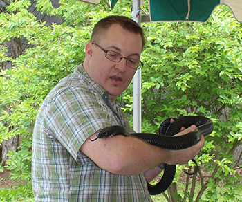 Mike Wines handles the rare Indigo Snake at the 2014 Alabama Book Festival in Montgomery.