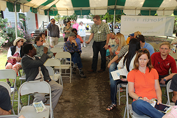 Mike Wines, author of Stupid Alabama, Showing Spotted Salamanderto audience at 2014 Alabama Book Festival