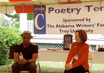 Randall Horton, author and poet, sits with Moderator Jeanie Thompson at the Poetry Tent during the 2014 Alabama Book Festival.