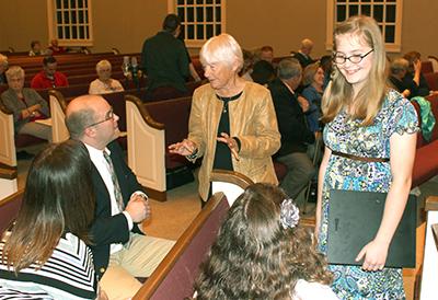 Composer Dr. Emma Lou Diemer talks with Cornett Family.  Molly Cornett (on right) had her poem, My Apple Orchard, set to music by Dr. Diemer.