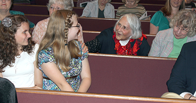 Molly Cornett and friend chat with HLA members Carol Roach and Rebecca Jones