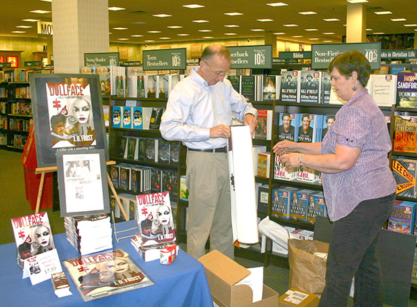 J.D. Frost, author of Dollface, and his wife, Donna, set up at Barnes and Noble