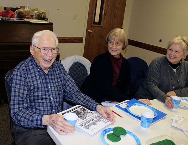 Joe Connaughton enjoys his copy of Old Huntsville Magazine with his feature story