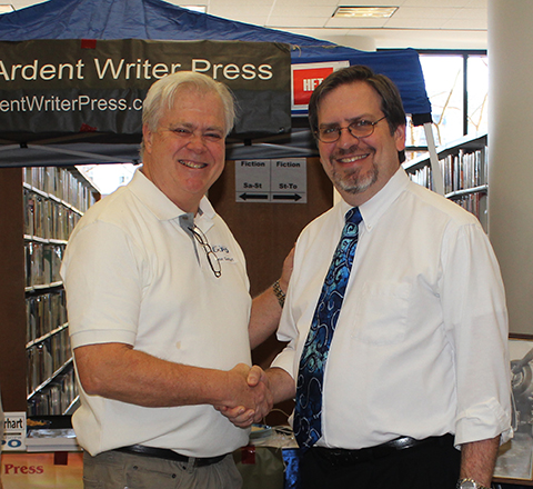 Publisher Steve Gierhart thanks Jared Millet, Library Event Coordinator, for a wonderful day