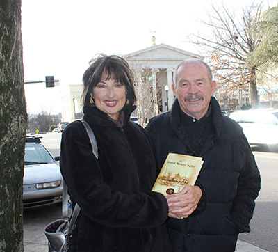Author Charles Farley with Old Huntsville Magazine Publisher Cathey Carney in Downtown Huntsville. Historic First National Bank, first in Alabama, is in background.
