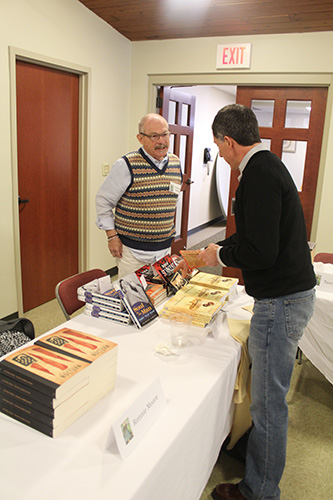 Author Charles Farley displayed his many novels and his biographical work