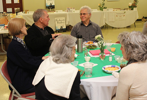 Several participants enjoy lunch and the personal touch of author Homer Hickam