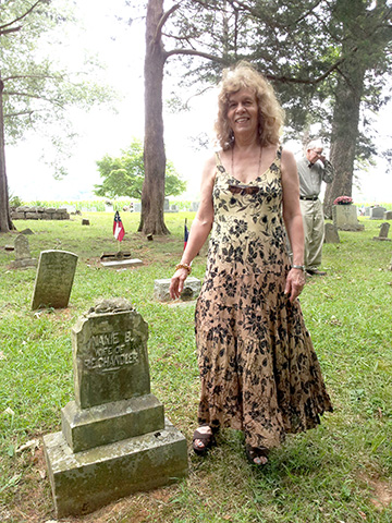 Nancy Owen Nelson at the grave site of her grandmother, Nannie B. Russell