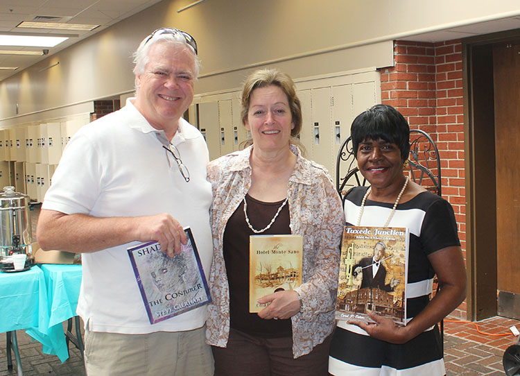 Carol Ealons, author of Tuxedo Junction-Right Back Where I Belong, shows her book along with Gierhart and his lovely wife, Bonny