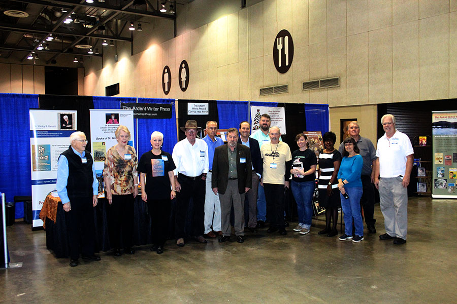 Group shot of Ardent Writer and Coffee Tree Writer participants at our booth at RCLF on Saturday, October 10