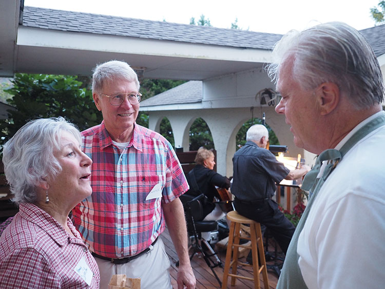 Nancy and Rich Corbeille are greeted by Ardent Writer publisher, Steve Gierhart. Bob and Leo Larkin provide entertainment in the background.