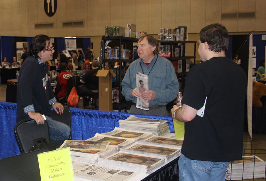 Roger Reid (center), producer of Alabama Public Television's Emmy awarded series, Discovering Alabama, talking to employees of The Valley Planet, local weekly based in Decatur.
